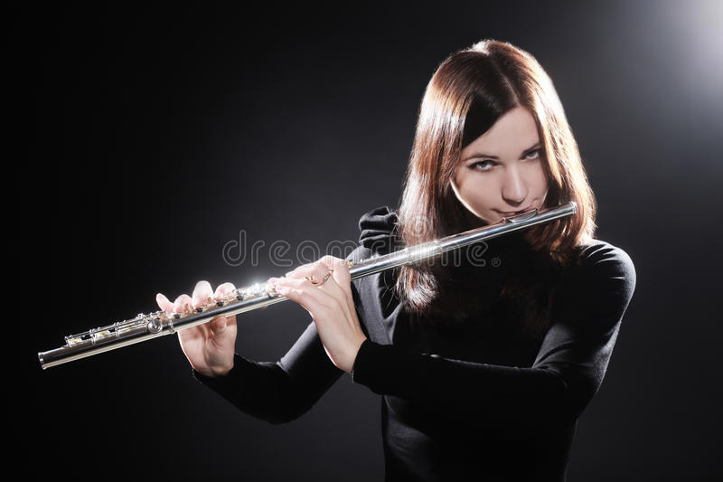 Flutist playing flute music stock images