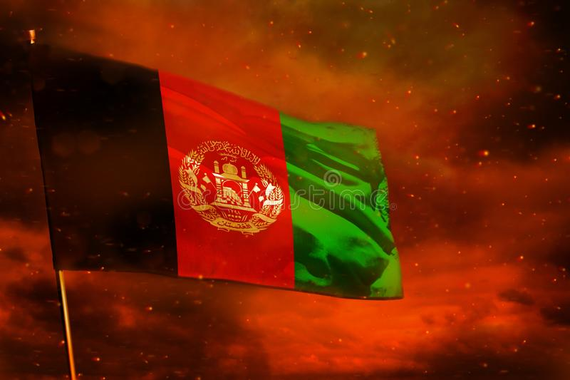 Fluttering Afghanistan flag on crimson red sky with smoke pillars background. Troubles concept. Fluttering Afghanistan flag on crimson red sky with smoke pillars royalty free stock photos