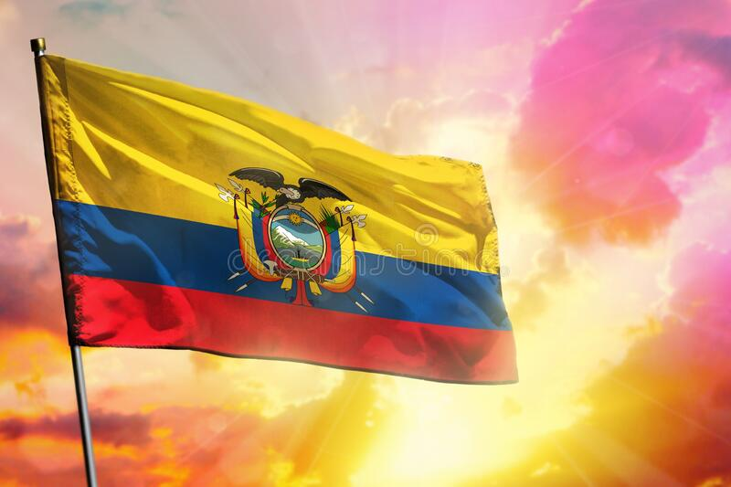 Fluttering Ecuador flag on beautiful colorful sunset or sunrise background. Success concept. Fluttering Ecuador flag on beautiful colorful sunset or sunrise royalty free stock image