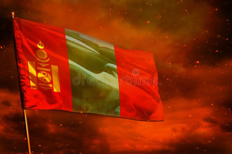 Fluttering Mongolia flag on crimson red sky with smoke pillars background. Troubles concept. Fluttering Mongolia flag on crimson red sky with smoke pillars royalty free stock photo