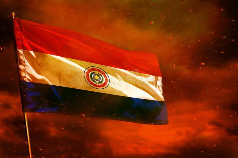 Fluttering Paraguay flag on crimson red sky with smoke pillars background. Troubles concept. Fluttering Paraguay flag on crimson red sky with smoke pillars royalty free stock photos