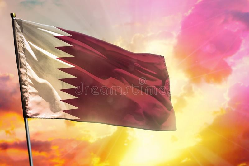 Fluttering Qatar flag on beautiful colorful sunset or sunrise background. Success concept. royalty free illustration