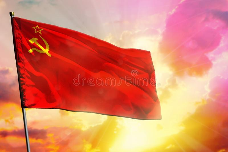 Fluttering Soviet Union SSSR, USSR flag on beautiful colorful sunset or sunrise background. Success concept royalty free stock photos