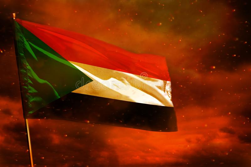 Fluttering Sudan flag on crimson red sky with smoke pillars background. Troubles concept. Fluttering Sudan flag on crimson red sky with smoke pillars background stock images