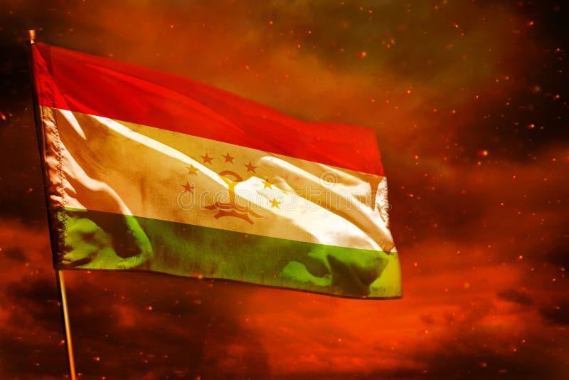 Fluttering Tajikistan flag on crimson red sky with smoke pillars background. Troubles concept. Fluttering Tajikistan flag on crimson red sky with smoke pillars royalty free stock photos