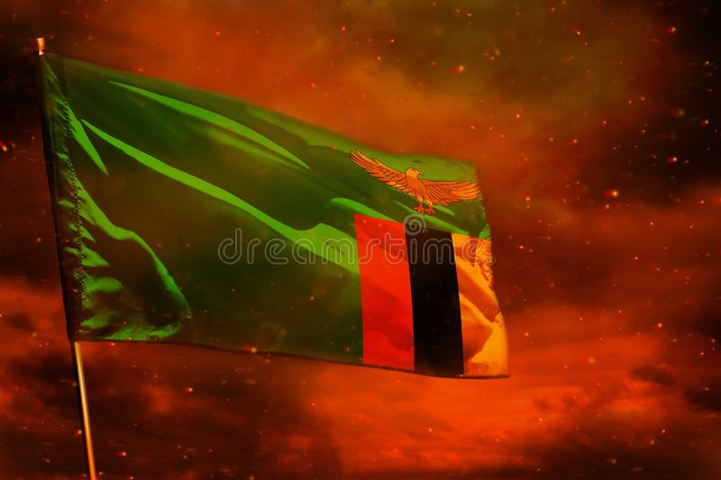 Fluttering Zambia flag on crimson red sky with smoke pillars background. Troubles concept. Fluttering Zambia flag on crimson red sky with smoke pillars stock image