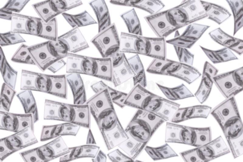 Flutuador de muitos dólares do borrão no ar fotos de stock royalty free