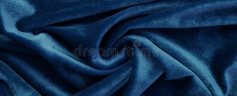 Fluweelachtergrond, textuur, blauwe kleur, dure luxe, stof, royalty-vrije stock afbeelding