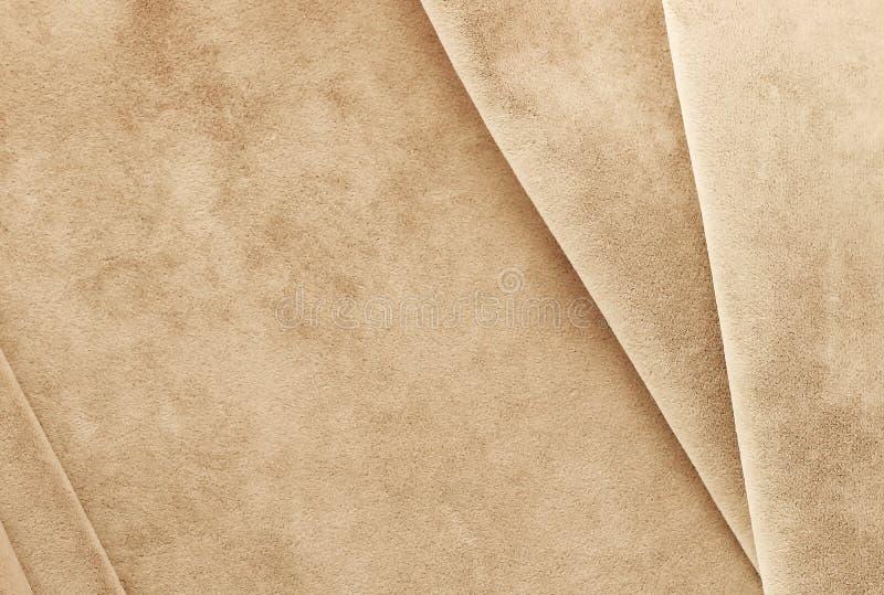 Fluweelachtergrond, textuur, pastelkleur bleke bruine kleur, dure luxe, stof, royalty-vrije stock foto