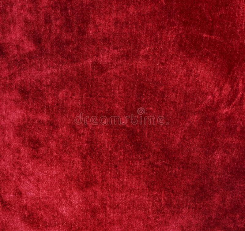 Fluweelachtergrond, textuur, rode kleur, dure luxe, stof, stock afbeelding