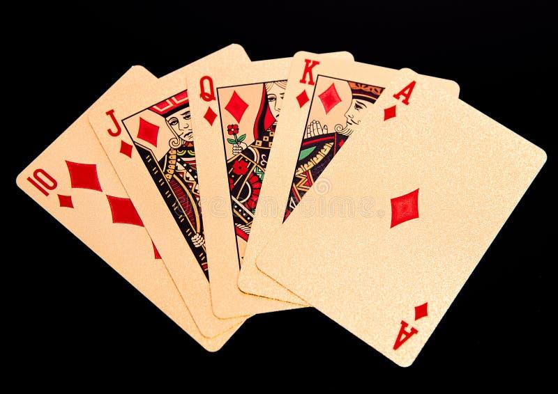 Flux droit royal jouant la main de poker d'or de cartes dans les diamants photographie stock libre de droits