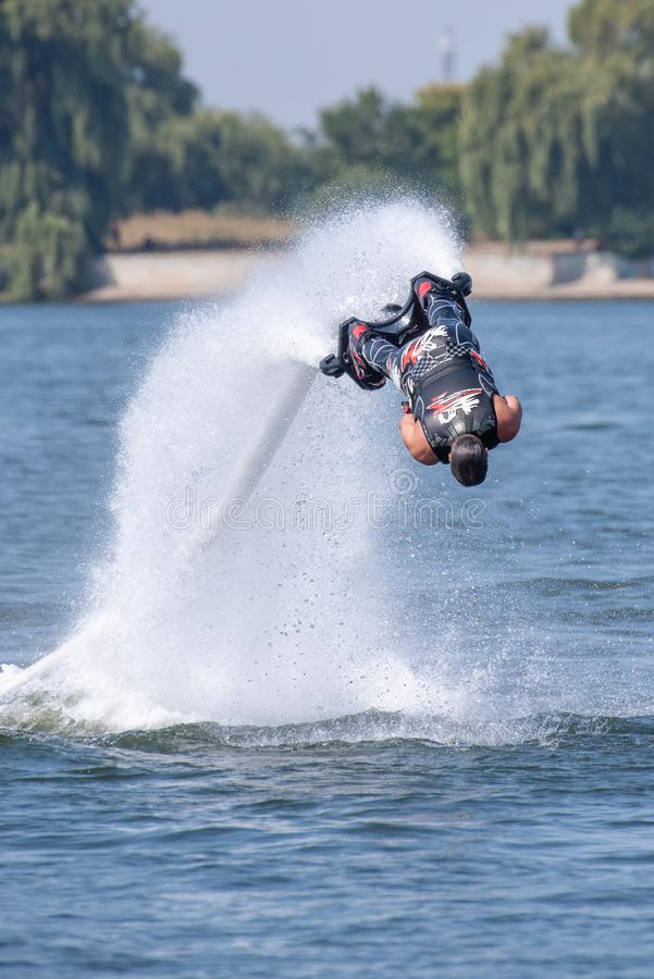Fly board extreme sports adventure , summer beach sports royalty free stock image