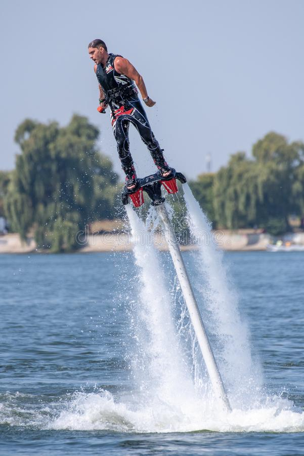 Fly board extreme sports adventure , summer beach sports stock photo