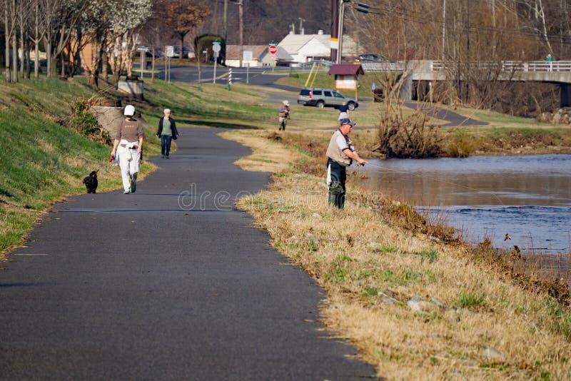 Fly Fishermen and Walkers. Roanoke County, VA – March 1st: Fly fishermen and walkers enjoying the Roanoke Valley Greenway on March 1st, 2017, Roanoke royalty free stock photography