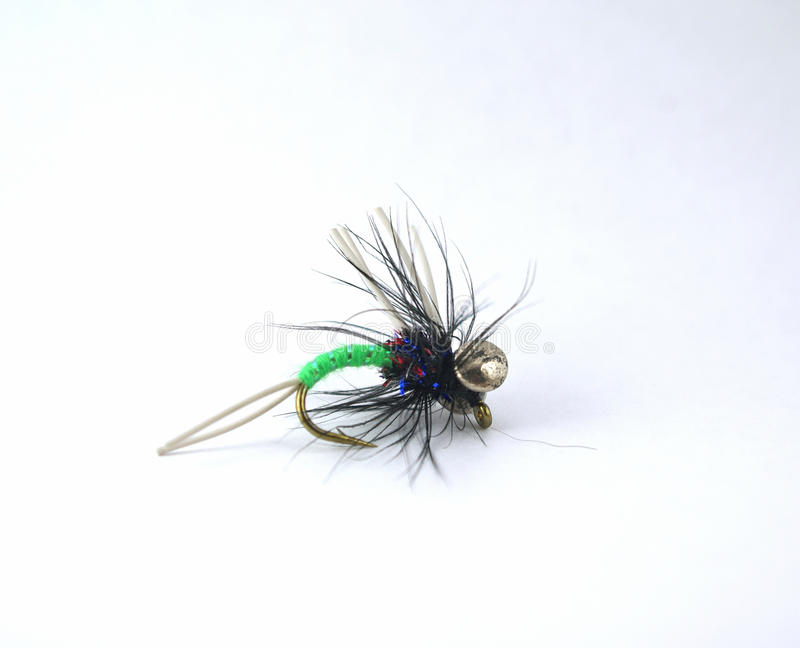 Fly for Fishing. Hand-tied fly for fishing royalty free stock image