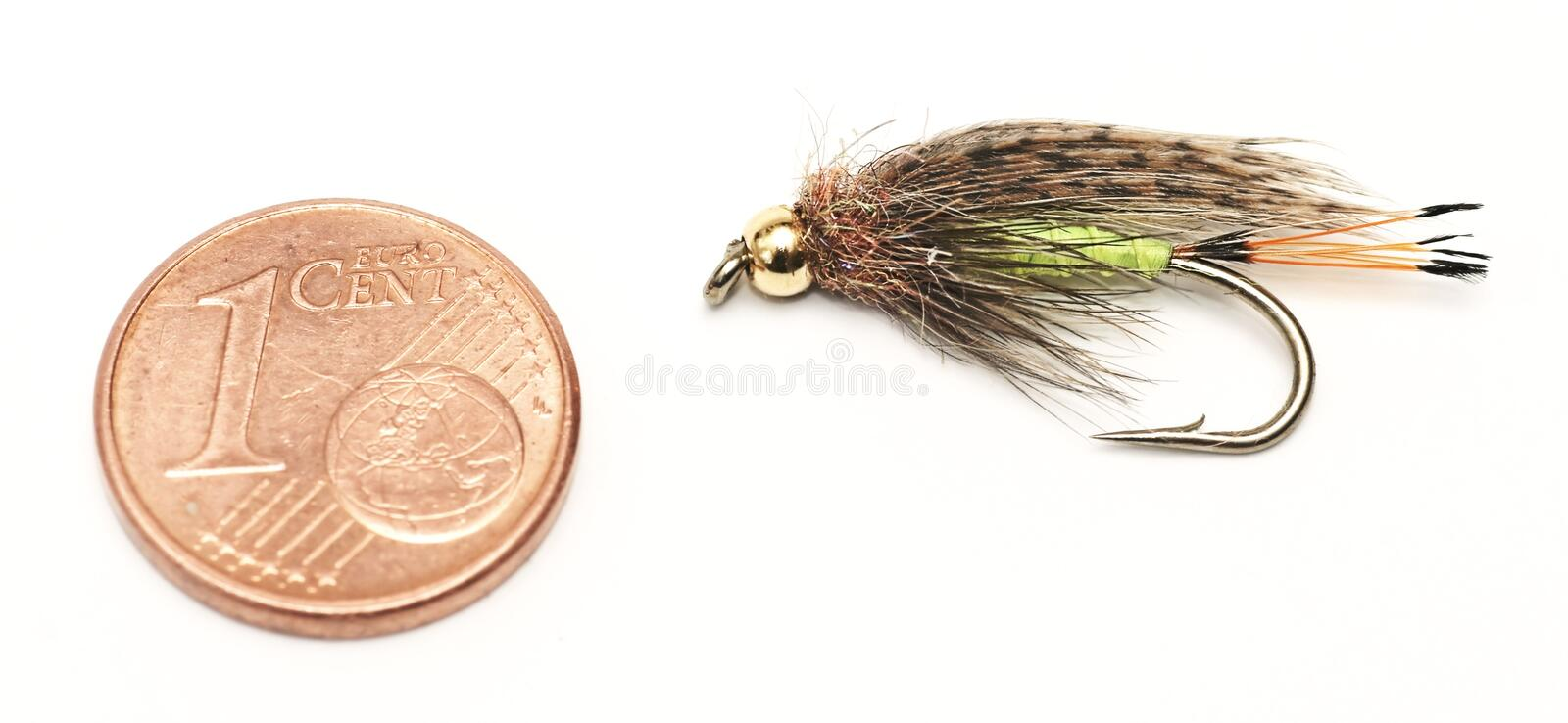 Fly fishing, bait, and one euro cent for size comparison. Fly fishing , bait, and one euro cent for size comparison stock photos