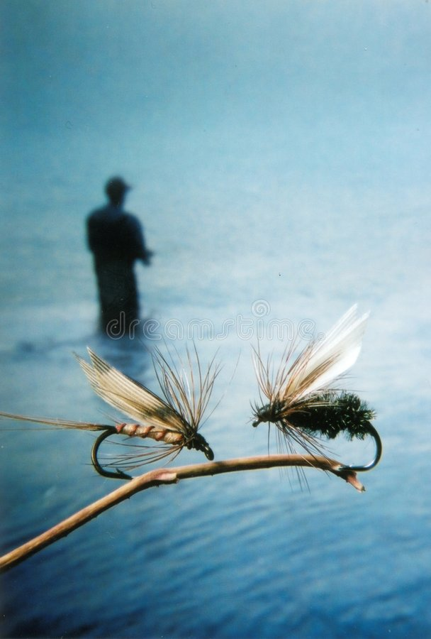 Fly fishing lures - flies with fisherman stock photos