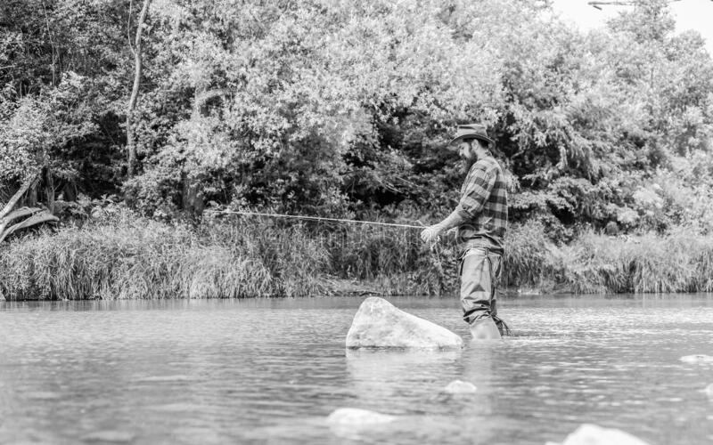 Fly fishing may well be considered most beautiful of all rural sports. Teach man to fish. Fishing outdoor sport. Fisherman catching fish. Fishing hobby. Calm stock images