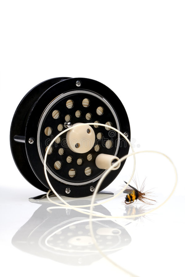 Fly Fishing Reel with Fly stock images