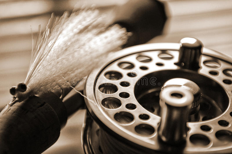 Fly fishing reel and lure on dock stock photos
