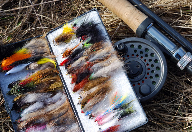 Fly fishing rod and fishing flies royalty free stock image