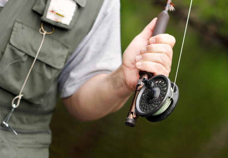 Fly fishing rod and reel royalty free stock photos