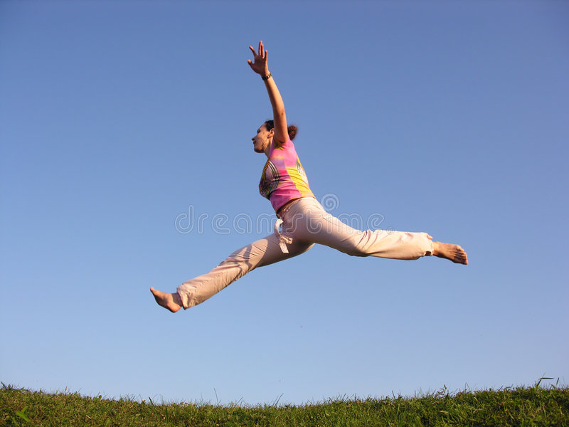 Fly girl. On blue sky stock image