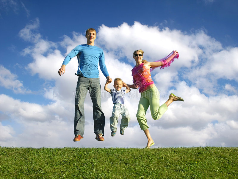 Fly happy family with clouds. Fly happy family on blue sky with clouds