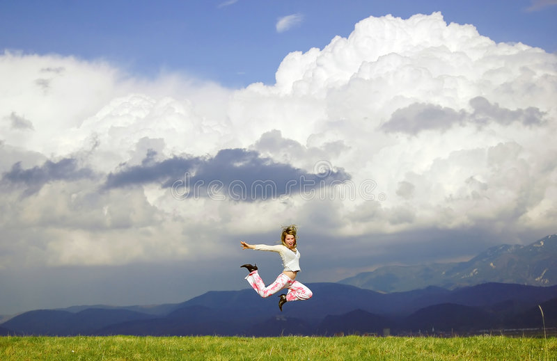 Fly happy woman. Happy woman in nature stock image
