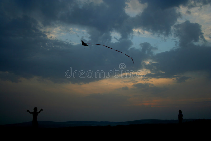 Fly a kite. Girl flying a kite stock image