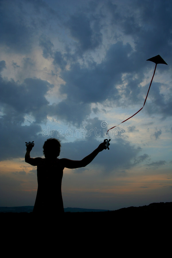 Fly a kite. Girl flying a kite stock photos