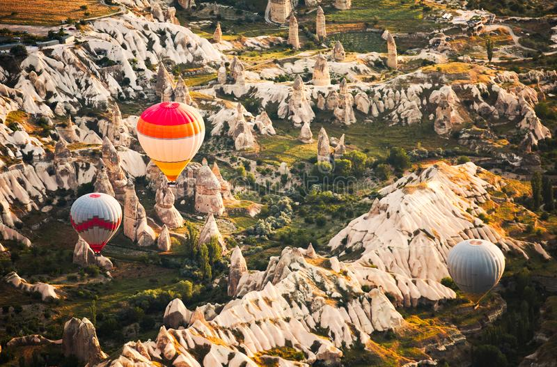 Fly over the Middle-earth. My early morning hot air balloon ride takes me over the magical world of the Middle-earth in Cappadocia. When the warm sun shines on royalty free stock image