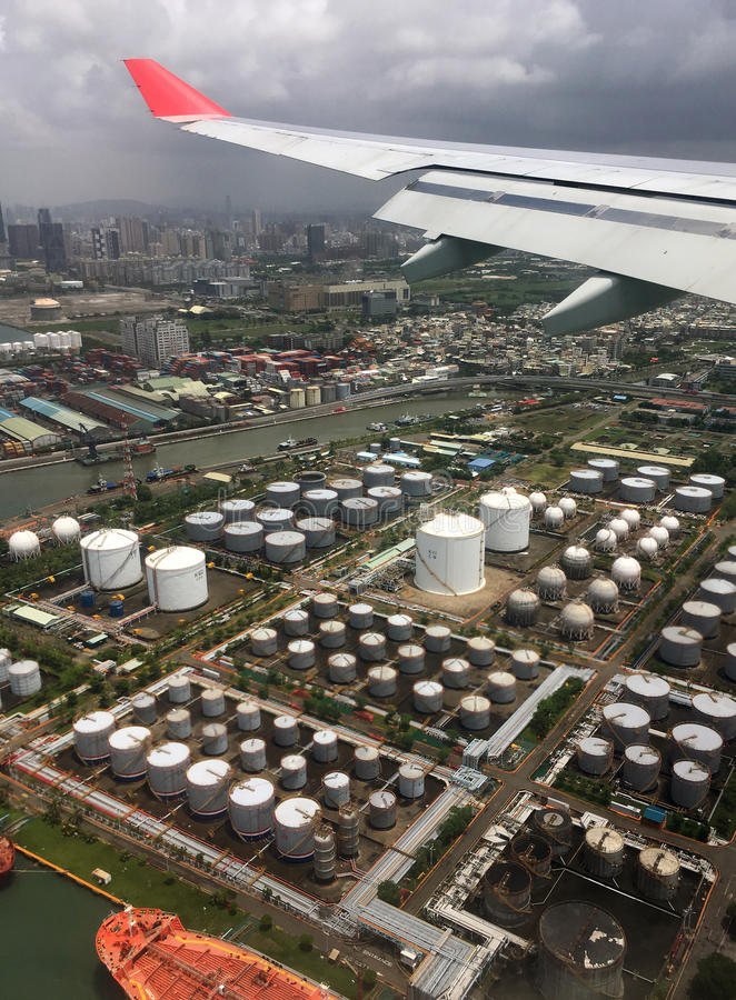 Fly over oil refinery tanks. Photo taken from flight to Kaohsiung, Taiwan. flying over the oil refinery tanks stock image