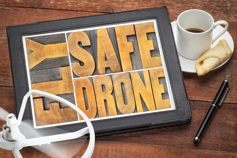 Fly safe drone word abstract on digital tablet royalty free stock image