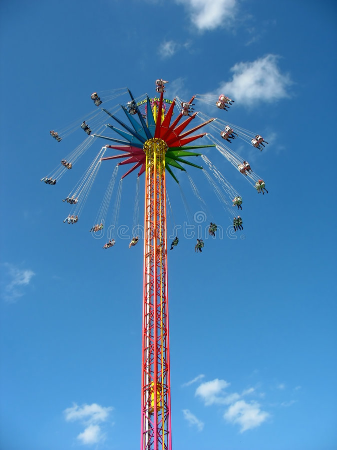 Fly in the sky - big colourful carousel. royalty free stock image