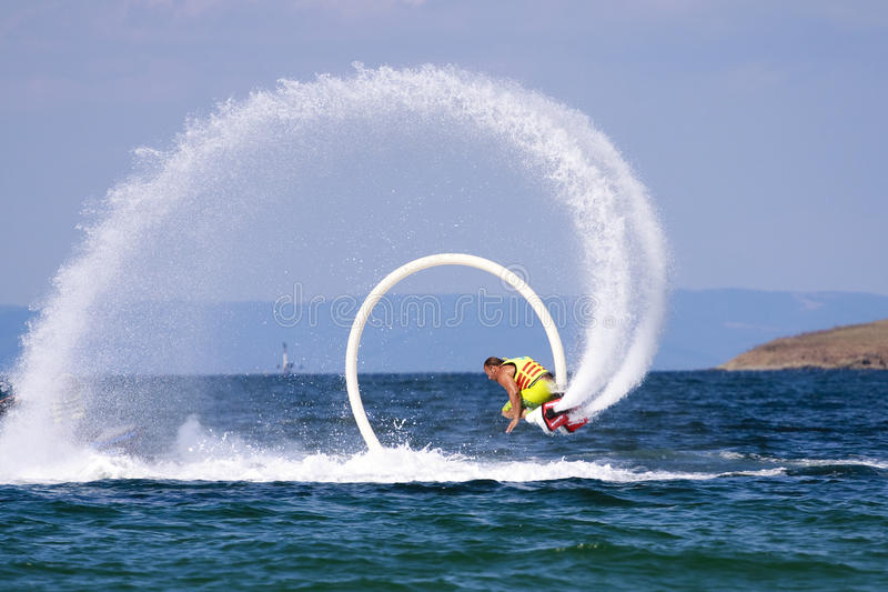 Flyboard Black sea adventure. Flyboard new water sport, is rapidly gaining popularity in many resorts in Bulgaria.Flyboard is a type of water jetpack attached stock photography