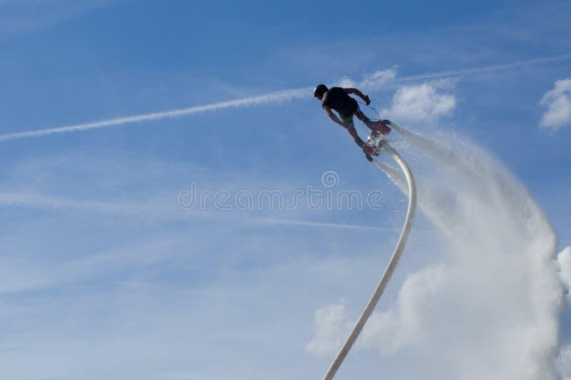 Flyboard - mensententoonstelling Flyboardingszitting stock foto's