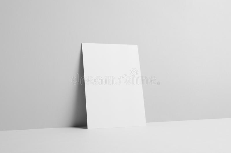A5 Flyer Mock-Up - Wall Background. A photo of a A5 Flyer Mock-Up on a wall background stock photo