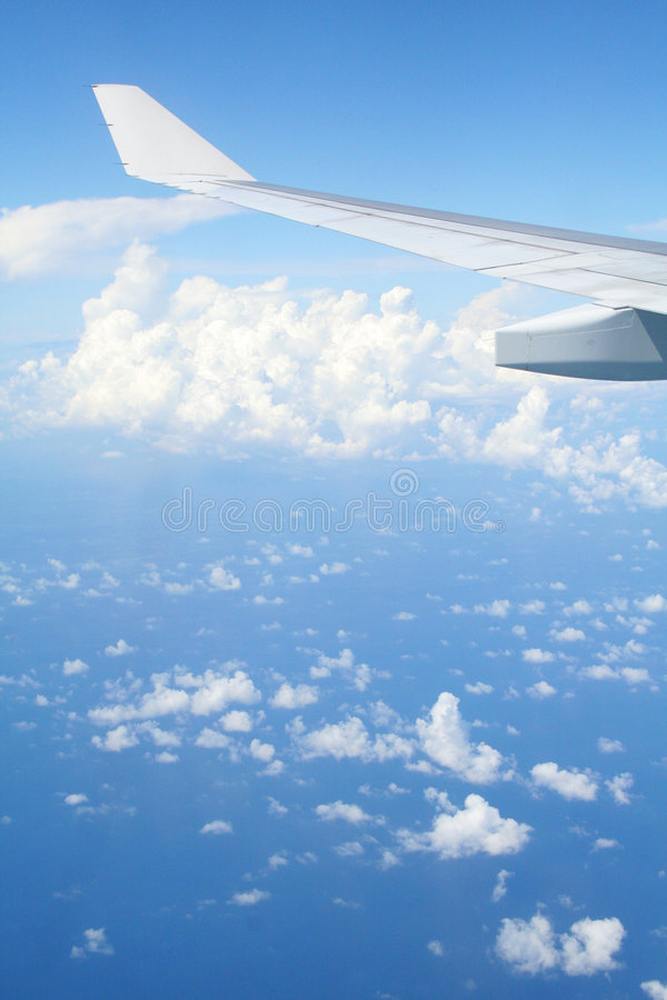Flyer's View. A flyer's view of a blue sky with puffy clouds stock photos