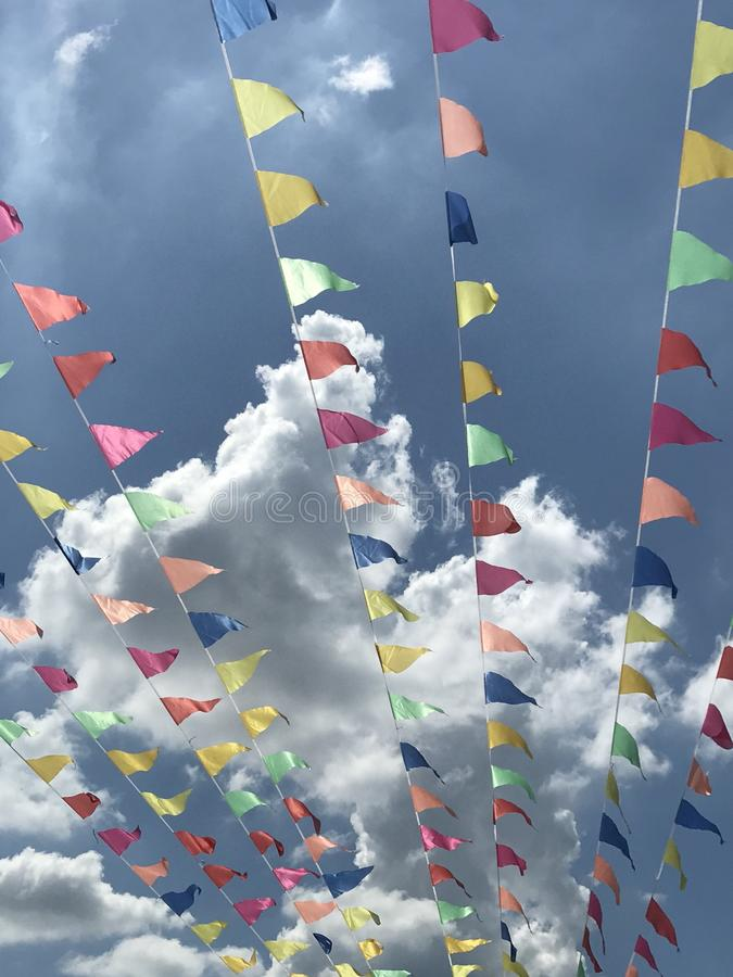 Flyers. Colourful flyers on a sunny hot day royalty free stock photography