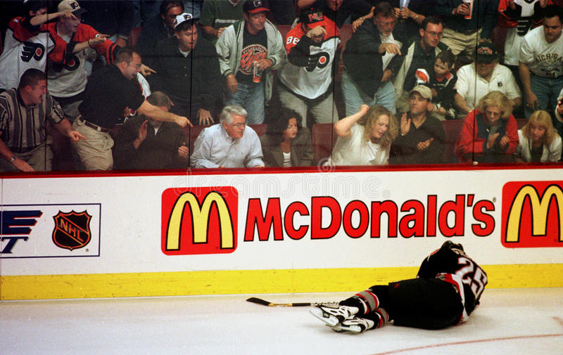 FLYERS FANS. Enjoy the injury of Buffalo Sabre winger Vaclav Varada in a 2001 playoff game. Varada wasn't seriously injured and remained in the game royalty free stock photos