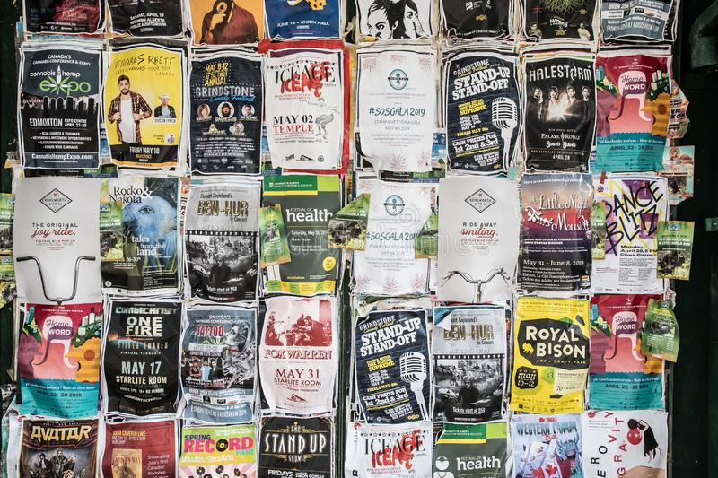 Flyers on the wall. Flyers for live shows in downtown Edmonton . A kaleidoscope of information and eye catching art work royalty free stock photo