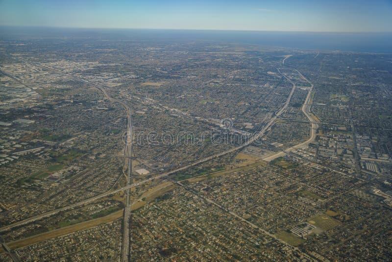 Flyg- sikt av Santa Fe Springs, Norwalkm blåklocka, Downey, VI royaltyfri bild