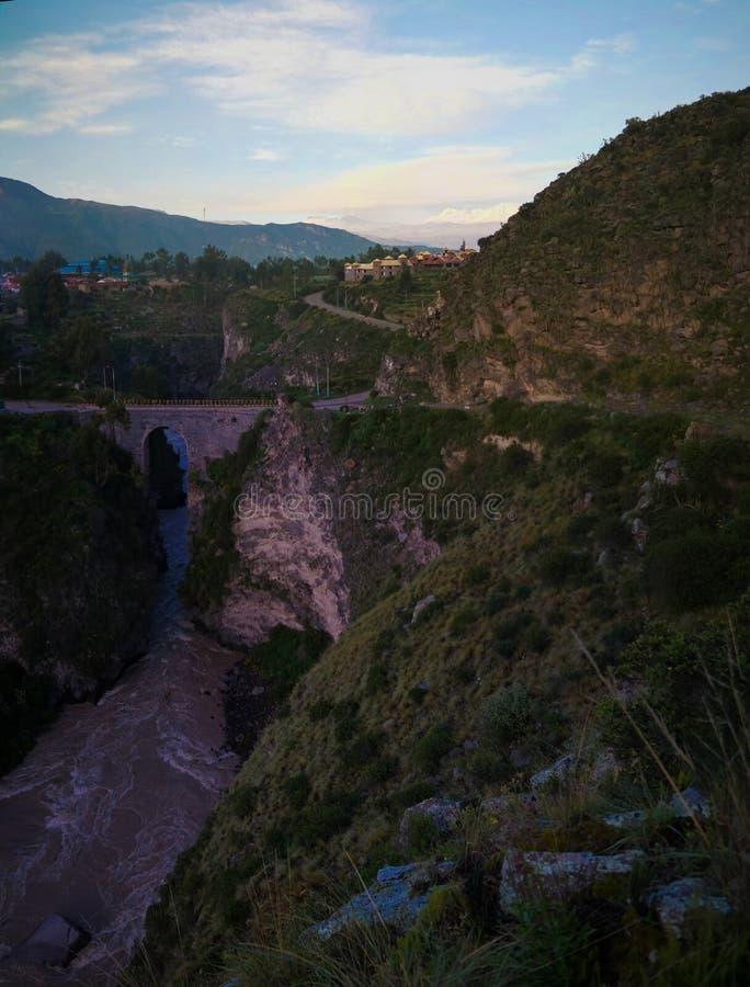 Flyg- soluppgångpanoramautsikt till den Colca floden, Sabancaya berg, Chivay, Peru fotografering för bildbyråer