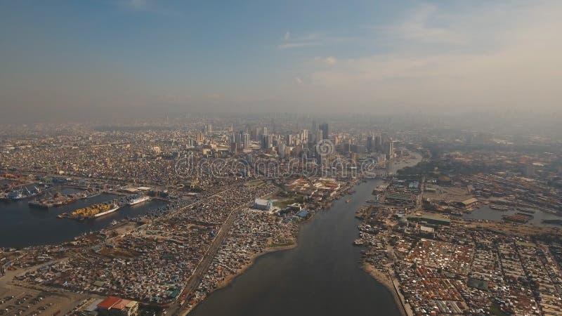 Flyg- stad med skyskrapor och byggnader Filippinerna Manila, Makati fotografering för bildbyråer