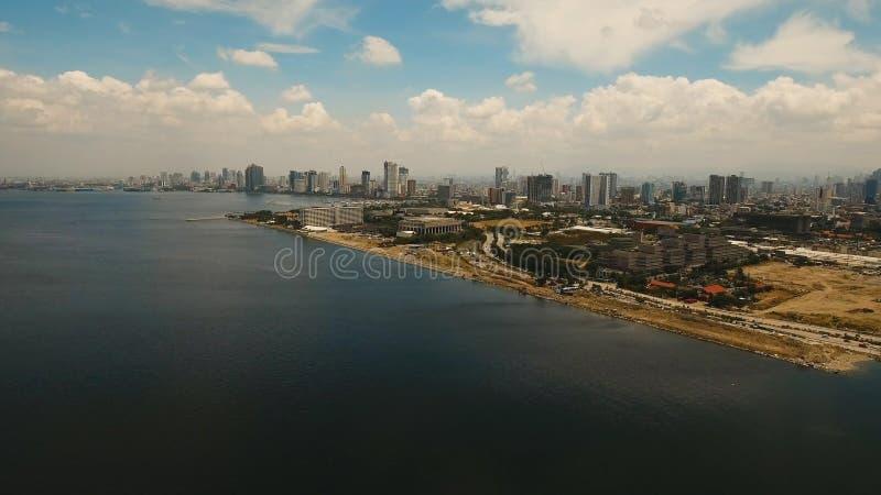 Flyg- stad med skyskrapor och byggnader Filippinerna Manila, Makati arkivfoto