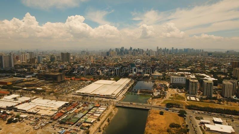 Flyg- stad med skyskrapor och byggnader Filippinerna Manila, Makati royaltyfria foton
