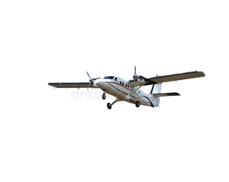 Flyga den lilla passagerarepropellernivån som isoleras på vit bakgrund Flygplan i flyg arkivbild