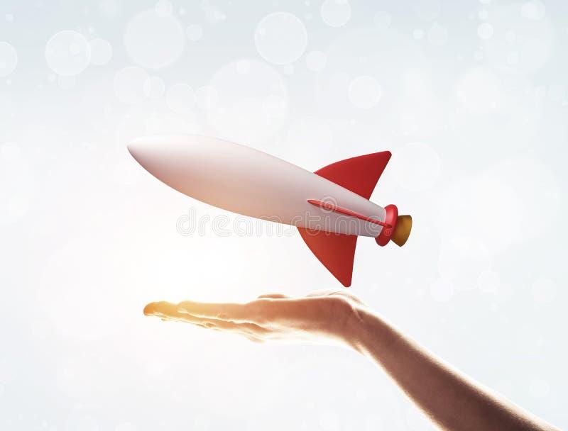 Flyga i hand som symbolet för höga teknologier och vetenskap fotografering för bildbyråer