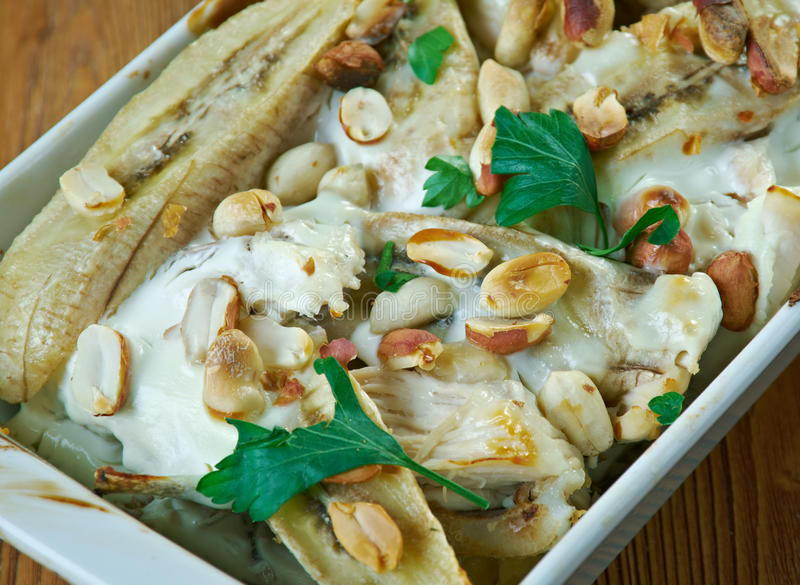 Flygande Jacob. Swedish casserole that consists of chicken, cream, chili sauce, bananas, roasted peanuts and bacon royalty free stock photos